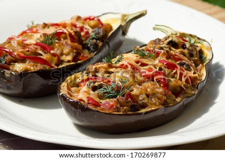 Aubergine stuffed with vegetables - stock photo