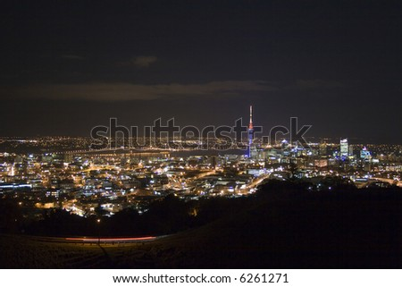 Auckland City New Zealand, showing the harbour bridge and Sky Tower at night - stock photo