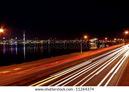 Auckland city skyline at night with light trails - stock photo
