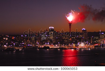 Auckland city skyline with fireworks exploding from the landmark Skytower building - stock photo