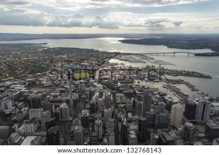 Auckland downtown/ Auckland central with the sky tower and harbour bridge clearly visible - stock photo