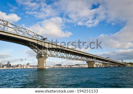 Auckland Harbor Bridge/ Auckland's iconic harbor bridge with the city in the background - stock photo