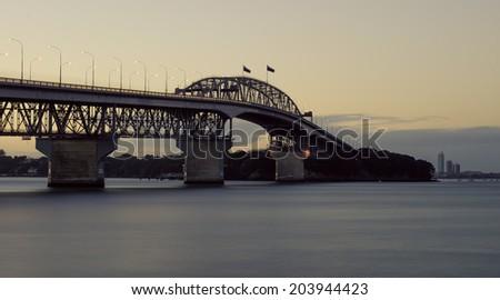 Auckland Harbour Bridge at dusk - stock photo