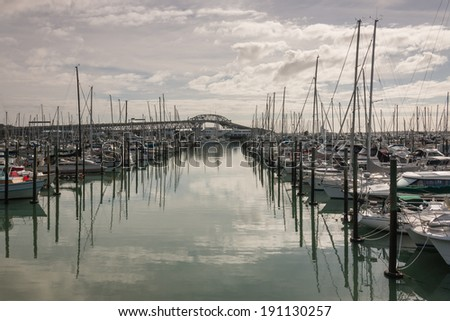 Auckland marina with Harbour Bridge in background - stock photo