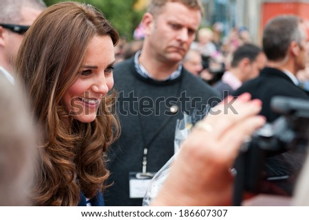 AUCKLAND, NEW ZEALAND - APRIL 11: The Duchess of Cambridge greeting crowds in Auckland�s Viaduct Harbour as part of the Royal New Zealand tour on April 11, 2014 in Auckland, New Zealand. - stock photo