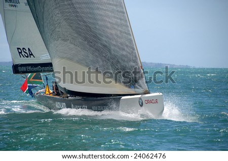 AUCKLAND, NEW ZEALAND - 30 JANUARY - 14 FEBRUARY, 2009: Louis Vuitton Pacific Series sees Americas Cup rival teams match race one another in other teams boats. Shown here is South Africa in USA Oracle's yacht practice - stock photo