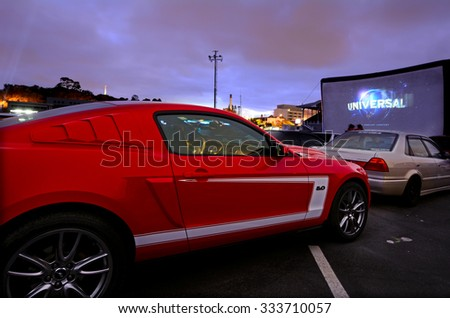 AUCKLAND - NOV 01 2015:Cars in Drive-in theater.Today there is only 400 drive-ins in the United States and 100 exist around the world mainly in Canada and Australia and it becoming popular in China. - stock photo