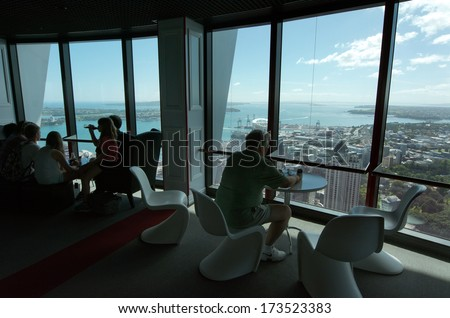 AUCKLAND, NZ - JAN 02: Visitors at the Sky Tower observation deck on Jan 02 2014.It's 328 metres (1,076ft) tall and it the tallest free-standing structure in the Southern Hemisphere. - stock photo