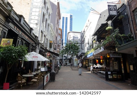 AUCKLAND, NZ - MAY 29:Vulcan Lane on May 29 2013.It's a popular cobblestone plaza off Queen St home to fashionable restaurants, cafes, pubs and stores. - stock photo