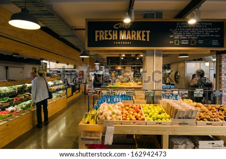 AUCKLAND, NZ - OCT 06:Visitors at Ponsonby Produce Market on Oct 06 2013.It's a new shopping center of mix of fresh produce, food, wine and cafes and restaurants opened in Auckland in July 2013. - stock photo