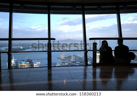AUCKLAND, NZ - OCT 08: Visitors at the Sky Tower observation deck on Oct 08 2013.At 328 metres, the Sky Tower is the tallest man-made structure in New Zealand - stock photo