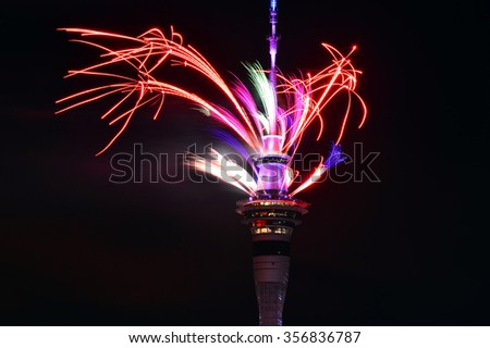 AUCKLAND,  NZL -  JAN 01 2016:Auckland Sky Tower displaying a spectacular firework display to celebrate 2016 New Year.New Zealand is one of the first countries to observe the New Year. - stock photo
