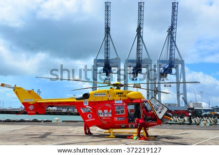 AUCKLAND, NZL - JAN 30 2016:Westpac Rescue Helicopter crew in Ports of Auckland.It's a New Zealand accident and emergency rescue and transport service operated by the Auckland Rescue Helicopter Trust - stock photo