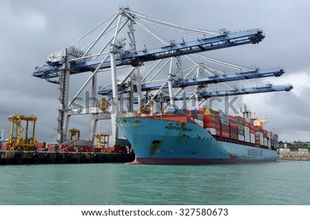 AUCKLAND,  NZL - OCT 13 2015:Big cargo ship unloading containers in Ports of Auckland New Zealand.Itâ??s New Zealand's busiest port and the third largest container terminal in Australasia. - stock photo