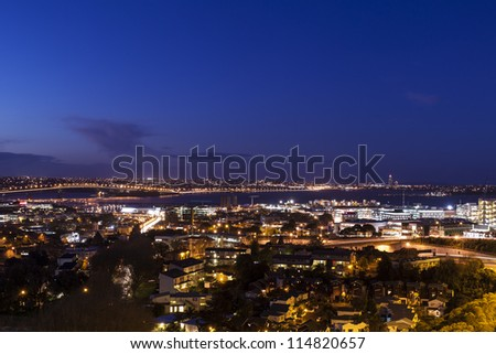 Auckland Skyline/ Auckland harbor and city at night - stock photo