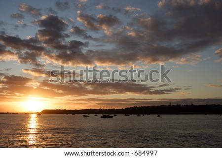 Auckland Sunrise taken from Tamaki Drive looking towards Orakei - stock photo