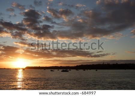 Auckland Sunrise taken from Tamaki Drive looking towards Orakei - stock photo