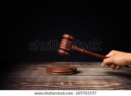Auction. Judge's holding wooden hammer - stock photo