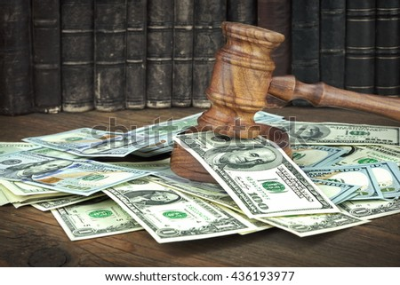 Auction Or Trial Concept With Auctioneers Or Judges Gavel And Scattered Money Heap On Wooden Table, Close Up, - stock photo