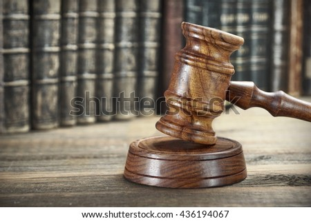 Auctioneer Or Judges Hammer or Gavel Among Old Vintage Books On Wooden Bench Or Table, Trial Concept, Auction Concept, Bidding Concept, Close Up - stock photo