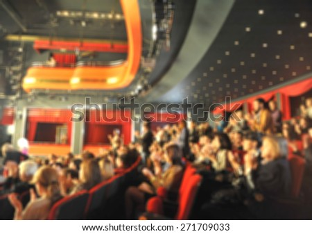 Audience in a theater, on a concert  and applauding - stock photo