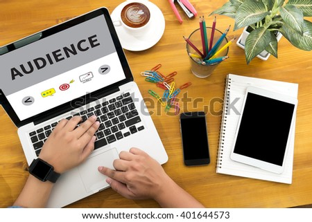 AUDIENCE Male person sitting front open laptop computer and smart phone with blank empty screen for your information or content,modern businessman work, top view - stock photo