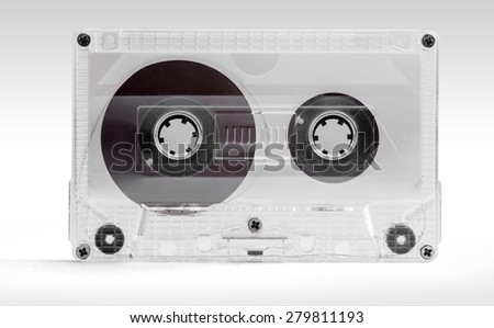 Audio cassette. Close up of a vintage transparent audio tape isolated on white background with clipping path.  - stock photo