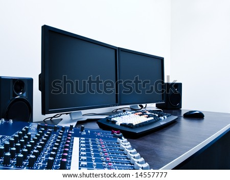 audio mixer and video editing workstation - stock photo