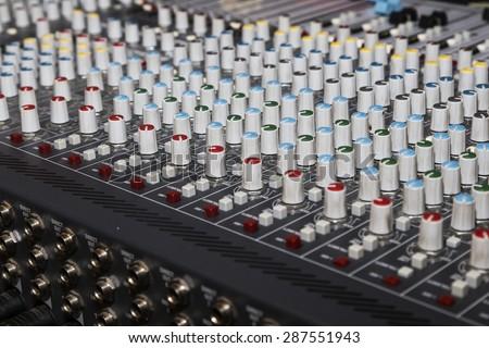 Audio mixer mixing board fader and knobs - stock photo
