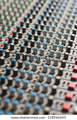 Audio mixing console closeup, music concept. - stock photo