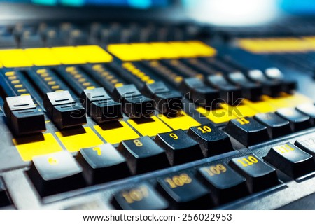 Audio sound mixer with buttons and sliders . Selective focus. A little of DOF.  - stock photo