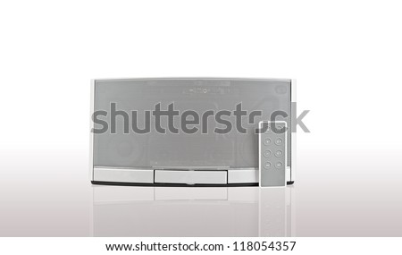 audio speaker on white background with remote control - stock photo