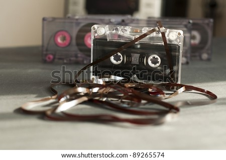 Audio tape cassette with subtracted out tape. Old broken cassette - stock photo