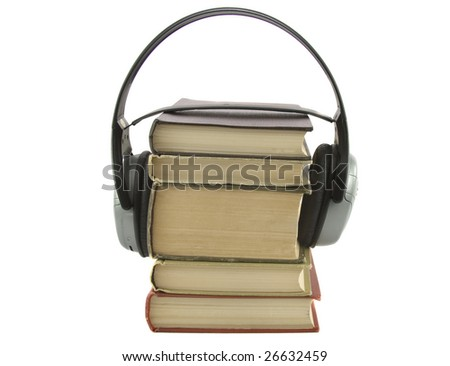audiobook conception with headphones and books isolated over white - stock photo