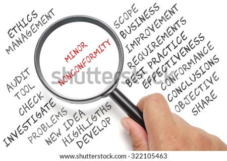 Audit, business conceptual focusing on Minor Nonconformity - stock photo