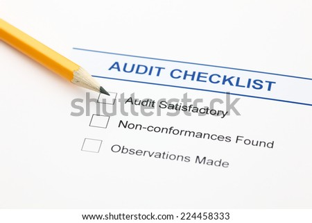 Audit checklist and pencil. - stock photo