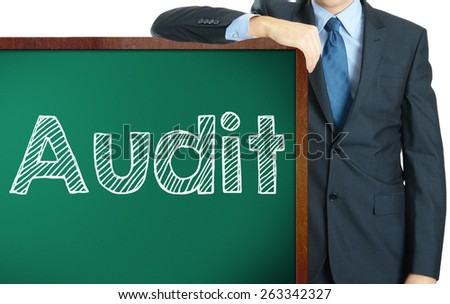 Audit on blackboard presenting by businessman or teacher - stock photo