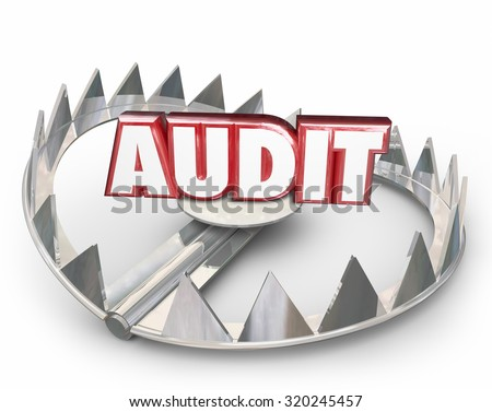 Audit word in red 3d letters on a steel bear trap to illustrate the danger of a tax review or evaluation with the internal revenue service or government - stock photo