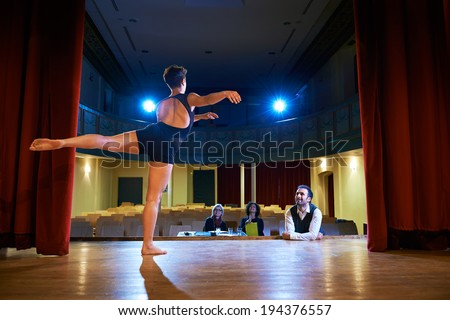 Audition with young dancer on stage, doing exam in theatre and dancing for director and staff - stock photo