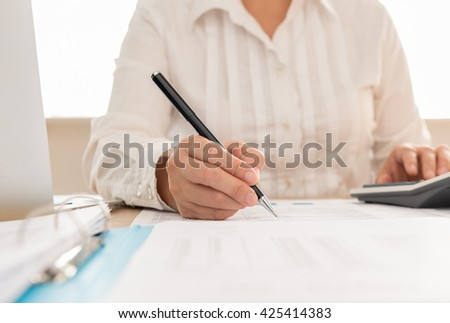 Auditor or internal revenue service staff checking annual financial statements of company.  - stock photo