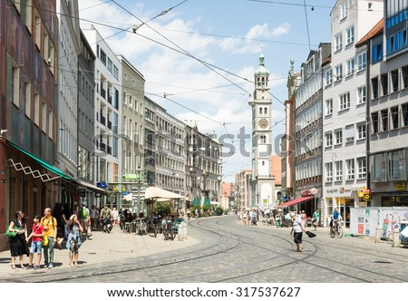 AUGSBURG, GERMANY - JULY 25: Tourists in the city of Augsburg, Germany on July 25, 2015.  It is the 2nd oldest town of Germany, visited by 600,000 tourists every year.  - stock photo