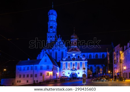 AUGSBURG, GERMANY - JUNE 20, 2015: The St. Ulrich Basilica is illuminated in blue at night during the festival 'the long night of lights' in Augsburg, Germany. Augsburg is an ancient roman city that - stock photo