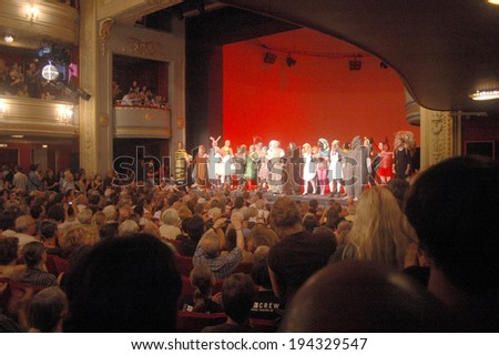 "AUGUST 26, 2007 - BERLIN: audience applausing in the ""Deutsches Theater"" (German Theater) on a festivity in the Mitte district of Berlin. - stock photo"