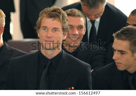 AUGUST 14, 2006 - BERLIN: Jens Lehmann, Lukas Podolski and Philipp Lahm at a reception for the German national soccer team after the world championship, Schloss Bellevue, Berlin. - stock photo