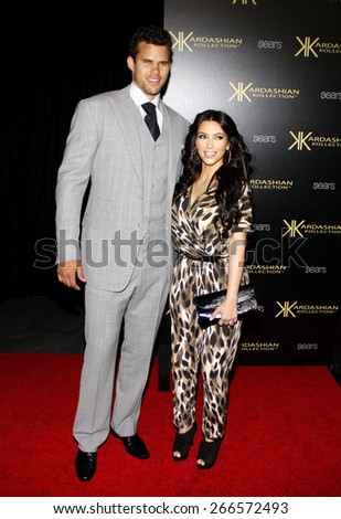 August 17, 2011. Kris Humphries and Kim Kardashian at the Kardashian Kollection Launch Party held at the Colony, Los Angeles.  - stock photo
