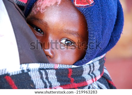 August 2014-Tanzania-Africa - An African unidentified child assisted by the Franciscan Mission of the village of Pomerini in the area affected by the virus AIDS. - stock photo