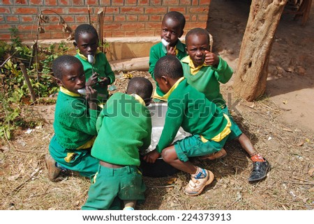 August 2014 - Village of Pomerini - Tanzania - Africa - The game of unidentified African children of asylum built in the Franciscan Mission of the Village of Pomerini in Tanzania. - stock photo