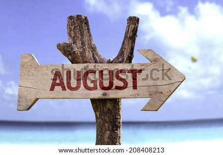 August wooden sign on a beautiful day - stock photo