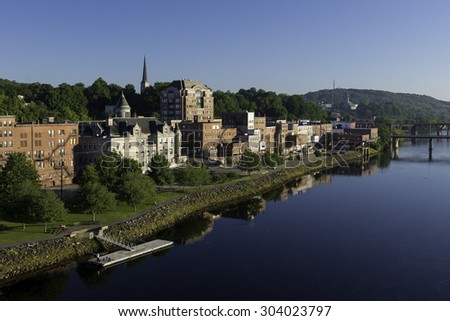 AUGUSTA, MAINE - JULY 31: Downtown Augusta and the Kennebec River from the Memorial Bridge on July 31, 2015 in Augusta, Maine - stock photo