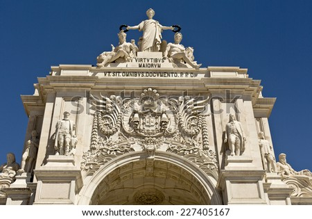 Augusta Street Arch is the triumphal arch connecting the Commerce Square to the Augusta Street. It has a clock and statues of Viriatus, Nuno Alvares Pereira, Vasco da Gama and Marquis of Pombal. - stock photo